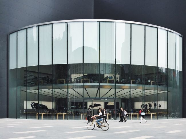 Transportation Men Bicycle Architecture Mode Of Transport Modern Person Apple Store Land Vehicle Lifestyles Built Structure City Life Leisure Activity Full Length City Cycling Riding Journey Office Building Day CyclingUnites