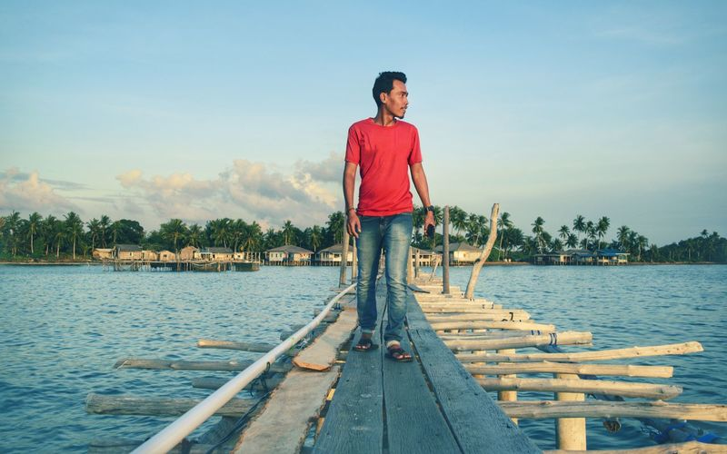 One Person Full Length Standing Casual Clothing Outdoors Jetty Real People Young Adult Red Enjoying Life Sky Sunlight Evening Afternoon Rear View Nautical Theme Nautical Landscape Sea Travel Destinations Multi Colored Scenics Sunset Beach Horizon Over Water