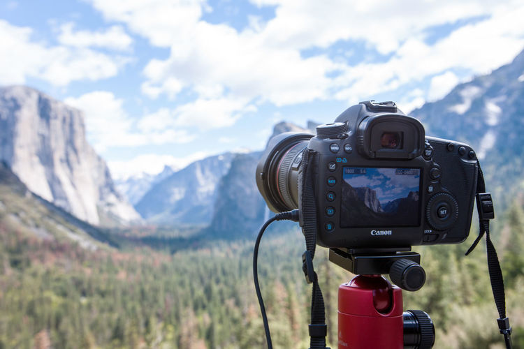 Close-up of camera against mountain