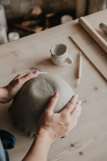 Midsection of woman at pottery workshop