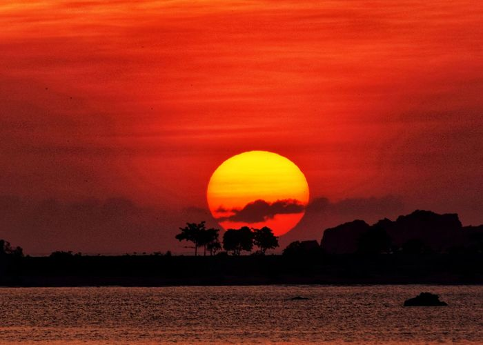 not africa, this is indonesia Peace Sea Ocean Mountain INDONESIA Sunset Sunlight My Best Photo Astronomy Sunset Red Silhouette Sun Astrology Sign Dramatic Sky Orange Color Romantic Sky Moody Sky Wave Shore Horizon Over Water Coast Calm