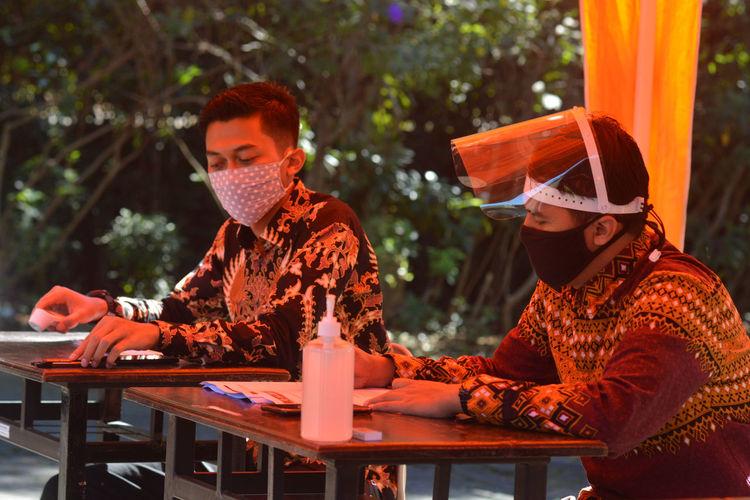 Men sitting on table