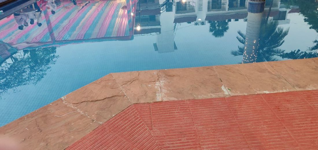 Water Swimming Pool Refraction Red Reflection Blue Summer Tile At The Edge Of Poolside
