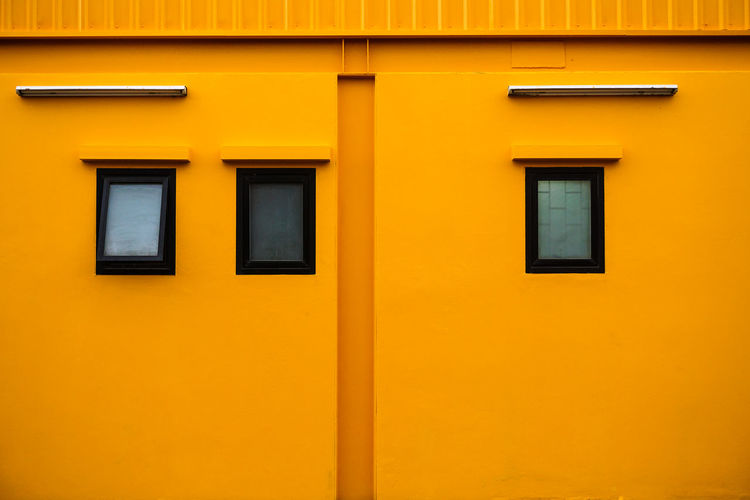 Yellow Of Wall With Window And Roof Architecture Backgrounds Building Building Exterior Built Structure City Closed Day Door Entrance Full Frame In A Row Low Angle View No People Orange Color Outdoors Residential District Wall - Building Feature Window Yellow