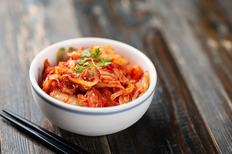 Kimchi cabbage Kimchi Korean Food Asian Food Bowl Cabbage Close-up Dieting Fermentation Focus On Foreground Food Food And Drink Freshness Healthy Eating Pickle Probiotic Ready-to-eat Still Life Table Vegetable Wellbeing Wood - Material