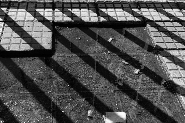 High angle view of shadow on footpath