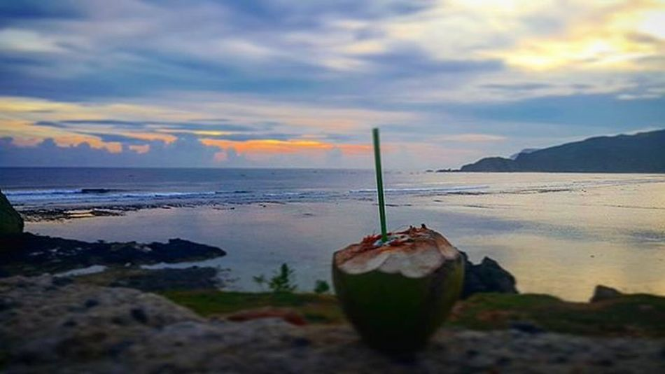 Enjoying a coconut... Agushariantophotography Coconut Beach Livingthedream Sunset Surfing Livingthedream Naturelovers