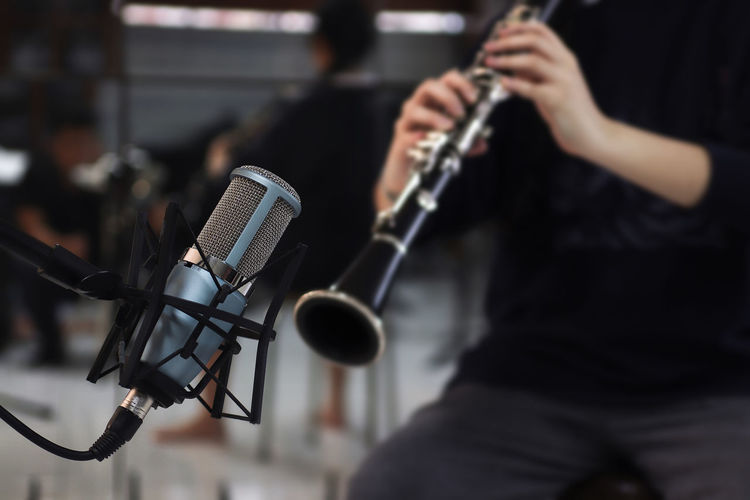 Microphone on Clarinet background Microphone Input Device Music Arts Culture And Entertainment Musical Instrument Artist Performance Musician Focus On Foreground Microphone Stand Occupation Equipment Stage - Performance Space Stage Indoors  Recording Studio Technology Rock Music Studio Musical Equipment