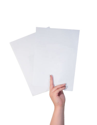 Hand raising white papers against white background Paper Holding Blank One Person Human Body Part Studio Shot Human Hand White Color Symbol Sign Quote Show Label Space Design Isolated White Background Copy Space Empty Business Demonstration Suggestions Sheet Template Arms Raised Communication