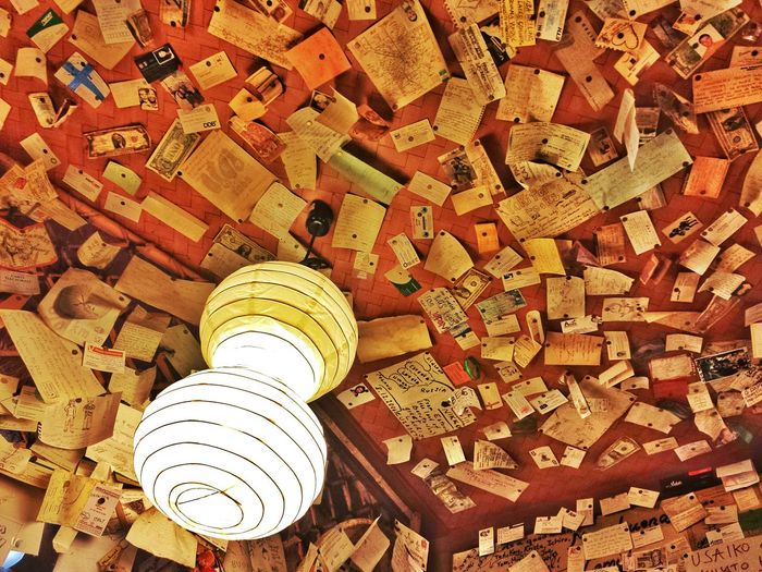 apparently one of the more often-visited-by-tourists restaurants, this was just a part of their ceiling. full of notes 📄 and notes 💷 -- there were even a few passport-sized photos -- all tacked on the walls. and the ceiling. now, how did they get up there? || Foodtrip Tourist Mode Travels Travel Traveling Travelling Explore Nippon