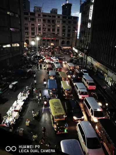 Manila Traffic City Transportation High Angle View Car Traffic City Street Street Building Exterior Night Illuminated Road Outdoors Architecture City Life Mode Of Transport Built Structure Aerial View Travel Destinations Yellow Taxi No People