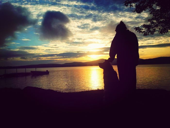 a girl her puppy and the sunrise
