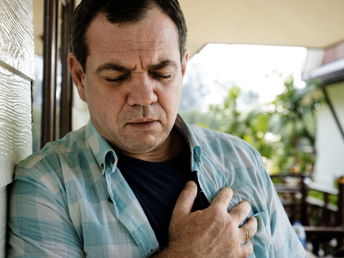 Mature man suffering from chest pain