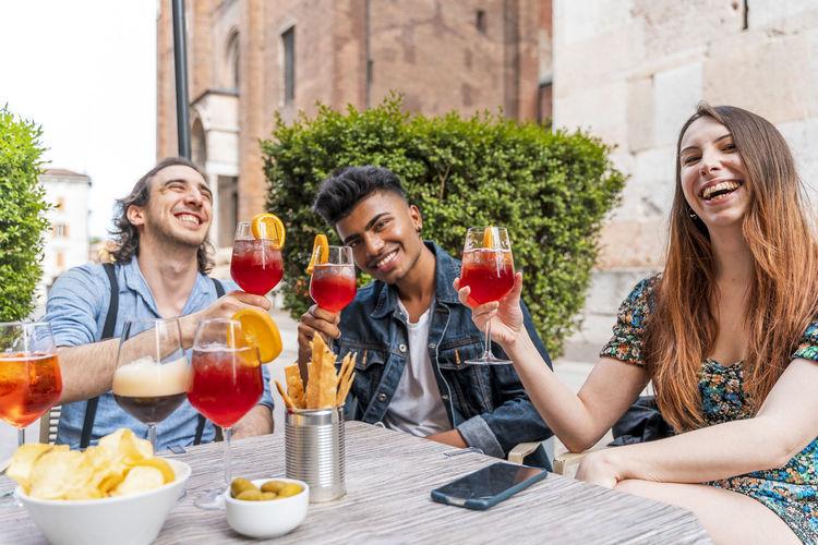 Portrait of friends holding drinks