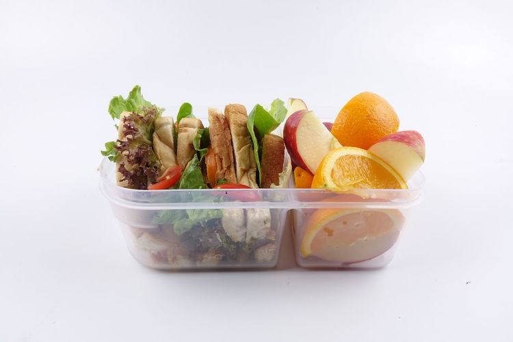 HEALTHY LUNCH BOX ISOLATED ON WHITE Bowl Citrus Fruit Close-up Copy Space Cut Out Food Food And Drink Freshness Fruit Healthy Eating Indoors  Lunch Box Meat No People Orange Ready-to-eat Salad Snack Still Life Studio Shot Vegetable Wellbeing White Background