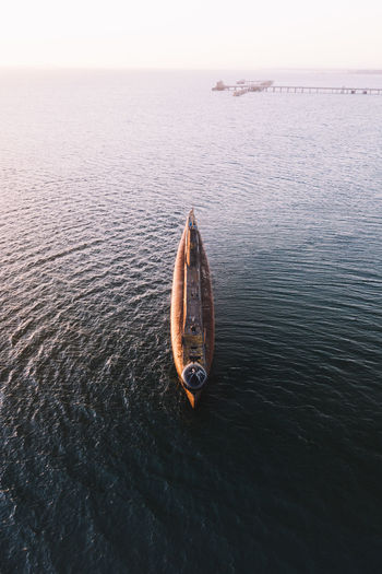 Aerial view of boat in sea against sky