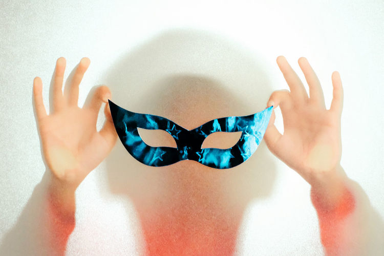 Human Hand Hand One Person Indoors  Human Body Part Close-up Body Part Studio Shot Blue Real People White Background Women Lifestyles Human Finger Finger Showing White Color Midsection Frosted Glass Mask Party Back Light Obscured Face Springtime Decadence