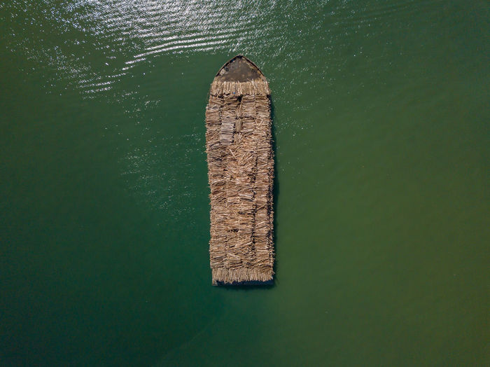 High angle view of a barge carrying timber.
