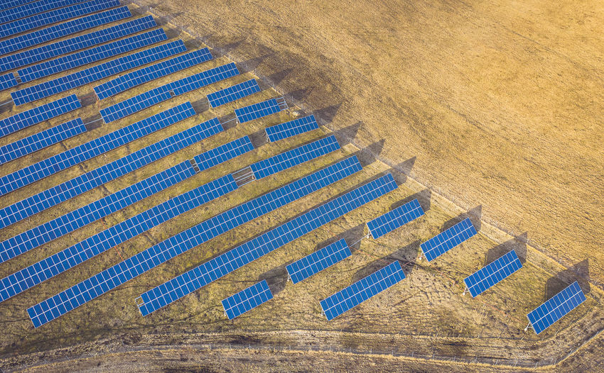 Aerial view of solar panels on land