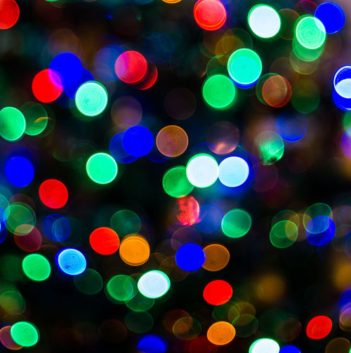 Twinkling colouring infecting us with festive spirit Abstract Backgrounds Black Background Blue Christmas Christmas Decoration Circle Close-up Decoration Defocused Ethereal Exploding Illuminated Light Effect Multi Colored Night Pattern Spotted Vibrant Color