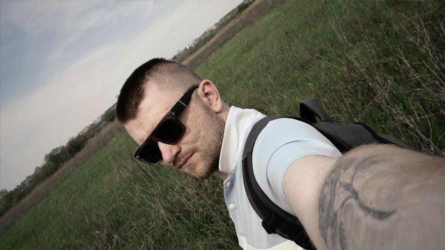 Tilt Image Of Handsome Man On Field