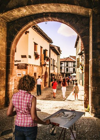 Built Structure Arch Rear View Person Day Archway In Front Of City Life Entrance Rural Village In The Street Painting In Progress Streetphotography Street Art Painter Acuarelas Covarrubias Burgos, Spain Castillayleon Pinturarapida Architecture Building Exterior Medieval Village EyeEm Gallery People And Places The City Light