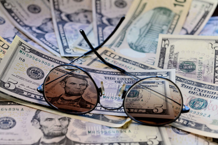 Sunglasses is placed on the banknote of US dollars spread around Dollar Money Cash Savings Banking Finance Bill Currency Wealth Background Banknote Bussiness Profit Green Close-up USD Exchange Loan  Paper Sign Payment Pay Stack Number Textured  Abstract Earnings Symbol Capital Assets Sunglasses Face President Business Paper Currency Backgrounds Full Frame No People Human Representation Indoors  Representation Still Life Male Likeness Large Group Of Objects Investment Economy