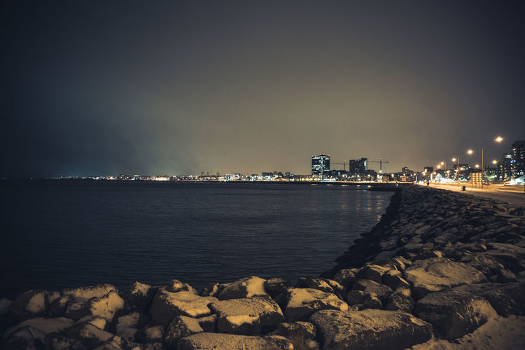 Looking out along a damp and snowy Reykjavik seafront. City Cityscape Harbour Harbour View Iceland Night Night Lights Outdoors Reykjavik Sea Snow Stormy Stormy Weather Travel Traveling Water Winter