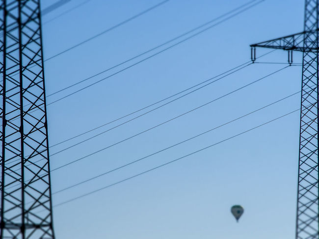 Electricity pylons in the fields Electricity Pylon Hot Air Balloon High Voltage Energy Cable Mast Power Station Energy Supply Technically