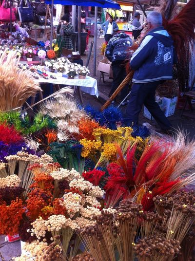Retail  For Sale Real People Market Choice Abundance Market Stall Large Group Of Objects Business Arrangement Variation Small Business Flower Retail Display One Person Flowering Plant Men Selling Sale Flower Arrangement Buying Bouquet Street Market Bunch Of Flowers
