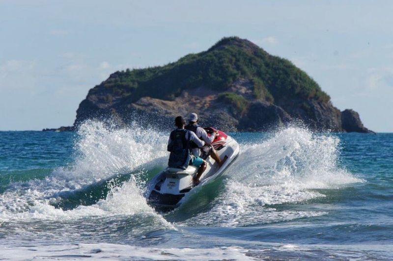 Watersport jetski Costa Rica Ocean fun joy vacation travel island tourism tourist wave recreation sports holiday