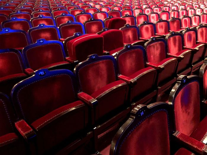 Full frame shot of empty chairs at movie theater