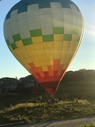 Hot-Air-Balloon landing in rural field sun set Hot Air Balloon Town Aerial View Sun Rays Color Image Green Color Agriculture Balloon Field Sunset Multi Colored Day Dreaming Enjoying Life Excitement Bliss Heaven Landscape Ballooning Festival Sky Lush Foliage Freedom No People Copy Space Fieldscape Adventure It's About The Journey
