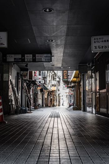 Fukuoka Japan Architecture Built Structure Building Exterior City The Way Forward No People Building Wall - Building Feature Footpath Street Text Outdoors Day Sign Store Communication Direction Transportation Flooring Ceiling