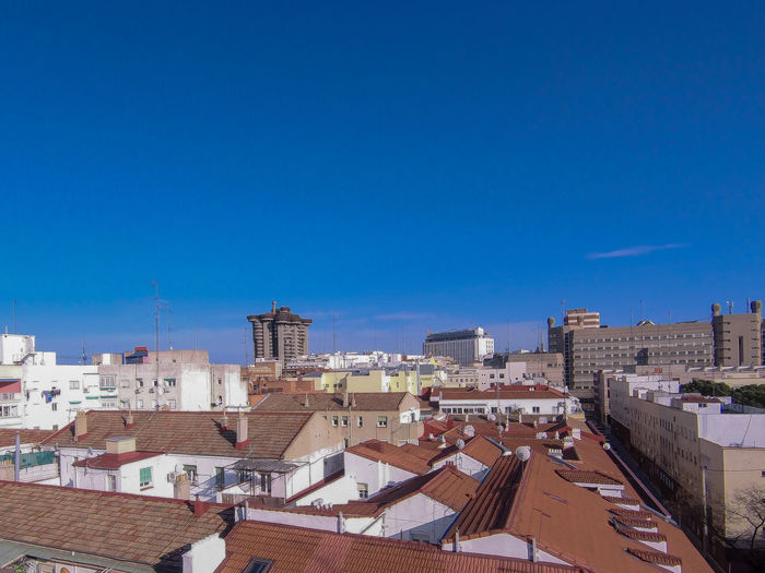 High angle view of townscape against blue sky