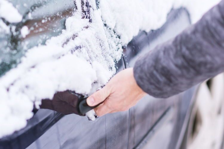Close up view of hand unlocking frozen car lock Adult Body Part Cold Temperature Day Finger Focus On Foreground Frozen Hand Holding Human Body Part Human Hand Human Limb Lifestyles Nature One Person Outdoors Real People Selective Focus Snow Snowing Warm Clothing Winter