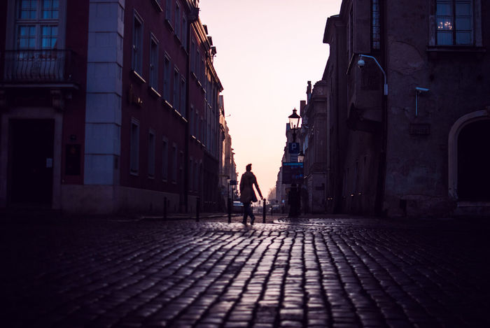 Building Exterior Center Cobblestones Dawn Discover Your City EyeEm Gallery Light And Shadow Nikon One Person People Silhouette Streetphotography Sunrsie The Week Of Eyeem Urban Winter