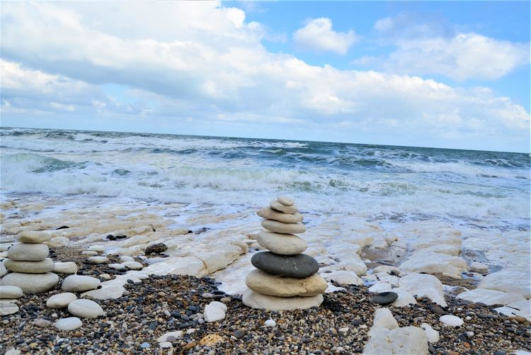 Sky Sea Water Horizon Over Water Stone - Object Cloud - Sky Scenics - Nature Beach Tranquil Scene Solid Beauty In Nature Rock Horizon Stack Balance Nature Zen-like Land Pebble No People Outdoors