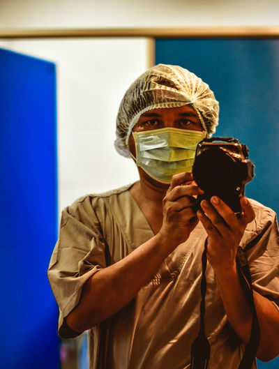 Portrait Of Surgeon Taking Selfie With Camera
