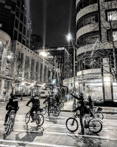 Bicycles parked on street at night