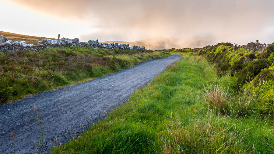 Stone Wall Sea Clouds Golden Hour Plant Sky Grass Road Nature Cloud - Sky Transportation Scenics - Nature The Way Forward Landscape Beauty In Nature Tranquil Scene Isle Of Man Round Table
