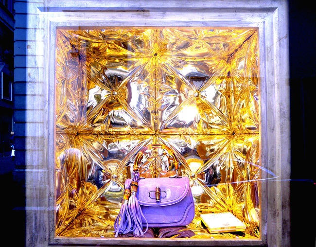 Eat The Rich Gold Gold Colored GUCCI Handbag  Light Money Can Buy Plastic Illusion Purple Flower Reflection Rome Italy Shopping Window