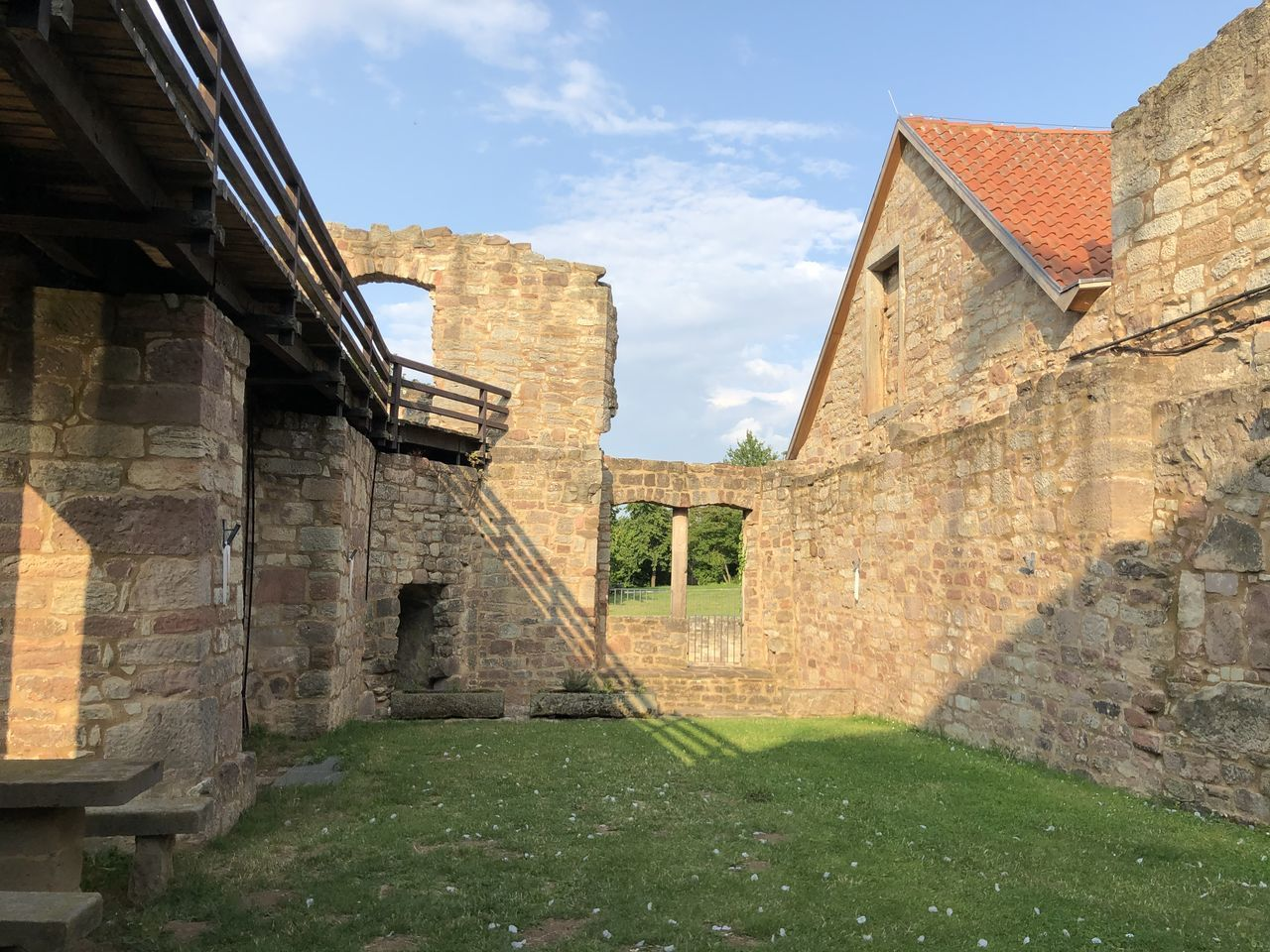 architecture, built structure, building exterior, building, sky, nature, the past, history, grass, day, cloud - sky, old, plant, no people, house, outdoors, wall, wall - building feature, sunlight, window, stone wall