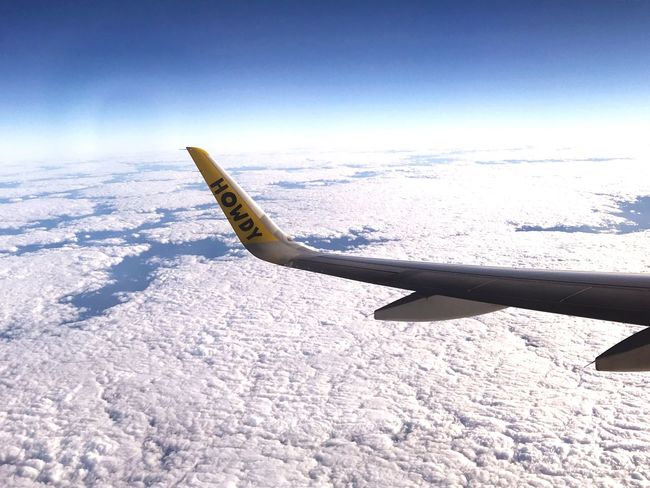 Airplane SpiritAIR Howdy Clouds Planet Earth Air Vehicle Mode Of Transport Transportation Airplane Wing Sky Flying Aerial View