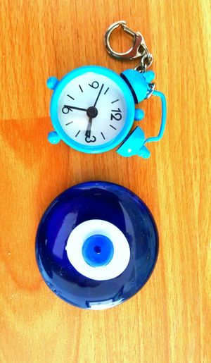 talisman clock on wood background Blue Eye Evil Eye Talisman Amulet I Put A Spell A On You Superstition  Clock Blue Wood - Material Close-up Instrument Of Time Hourglass Clock Hand Time Alarm Clock 12 O'clock Clock Face