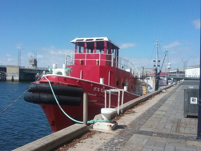 Wharf Side Outdoors Harbor No People Red Tug Boat Boat Water Blue Sky Bridge In Background