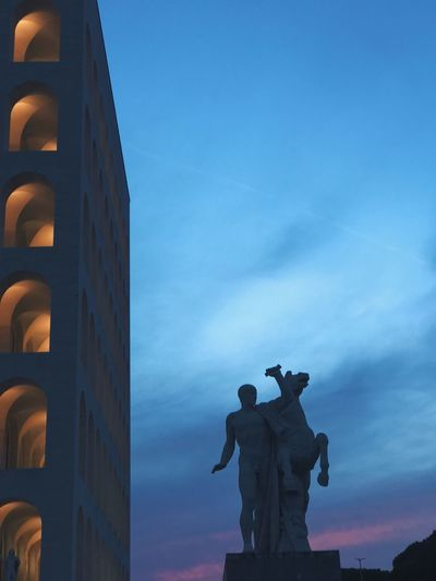 Colosseo Quadrato Cielo Statua Dawn Tramonto Sculpture Statue Art And Craft Sky Representation Human Representation Male Likeness Architecture Blue Creativity Low Angle View Outdoors Built Structure Cloud - Sky Nature Building Exterior Day The Architect - 2018 EyeEm Awards
