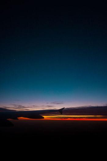 Illuminated road against sky at night