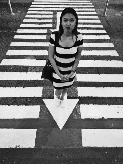 A friend of mine, just playing around with the lines. Pedestrian Walkway Zebra Crossing Pedestrian Crossing Stripes Pattern Striped Only Women One Woman Only
