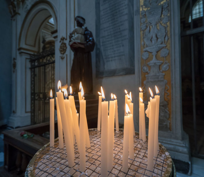 Votive candles in roman catholic church in Rome Candle Candles Catholic Chapel Church Roman Catholic Rome Blessing Candlelight Italy Prayer Prayer Candles Votive Votive Candle